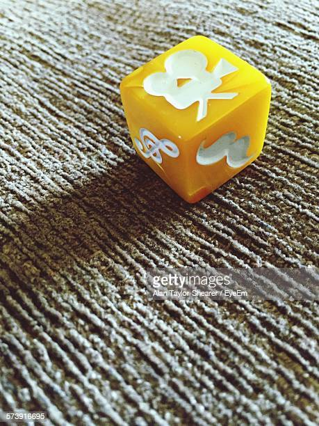 close-up of yellow hipster dice on fabric - chiave di violino foto e immagini stock