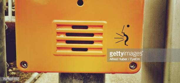close-up of yellow intercom on pole - intercom stock photos and pictures