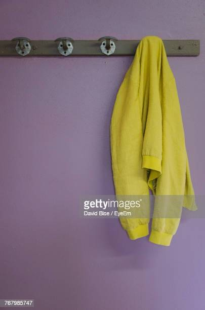 Close-Up Of Yellow Jacket Hanging On Rack At Home