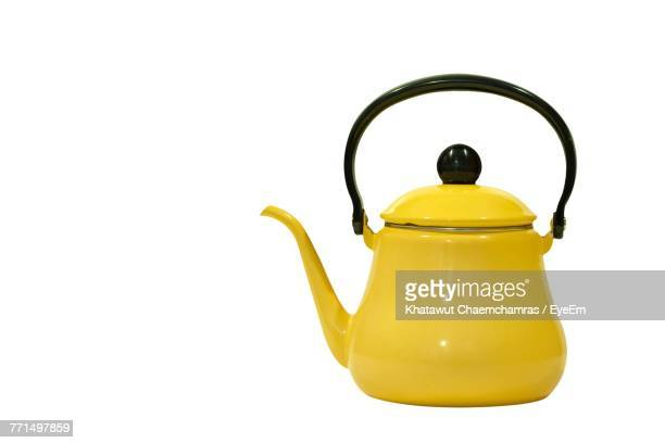 close-up of yellow kettle over white background - appliance stock pictures, royalty-free photos & images
