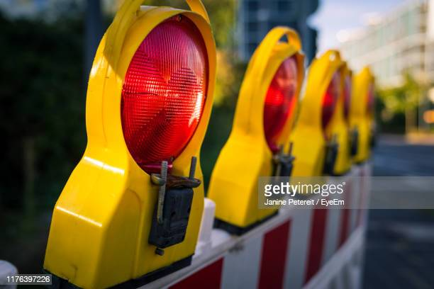 close-up of yellow lights on road - barricade stock pictures, royalty-free photos & images