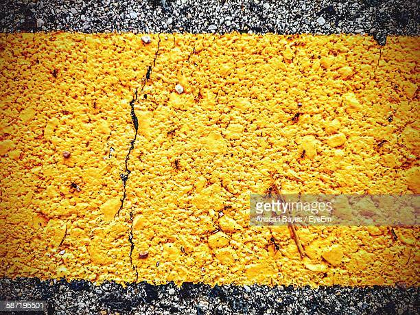 Close-Up Of Yellow Line Painted On Street