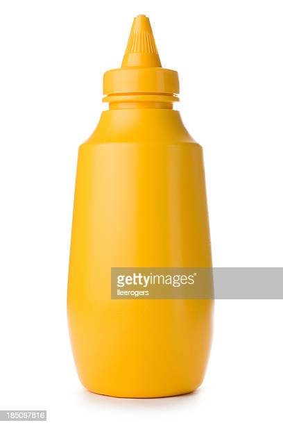 close-up of yellow mustard bottle on a white background - sauce stock pictures, royalty-free photos & images