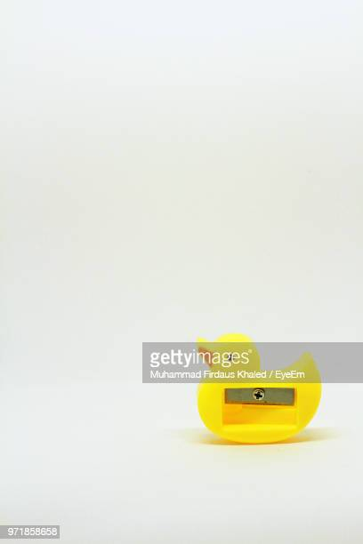 Close-Up Of Yellow Pencil Sharpener Over White Background