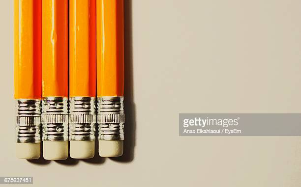 Close-Up Of Yellow Pencils Arranged On Table