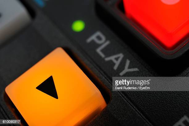 close-up of yellow play button - play button stock photos and pictures