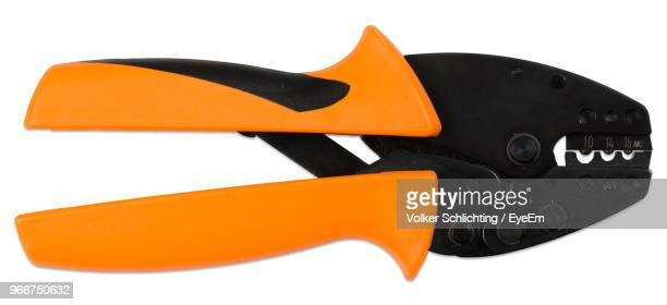 Close-Up Of Yellow Pliers Over White Background