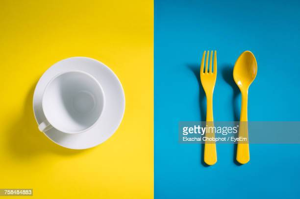 close-up of yellow spoon and fork - silverware stock pictures, royalty-free photos & images