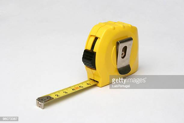 Close-up of yellow tape measure with metal clip