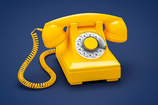 Close-Up Of Yellow Telephone On Blue Background - gettyimageskorea
