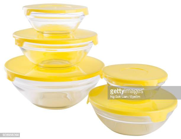 close-up of yellow tiffin box against white background - tiffin box photos et images de collection