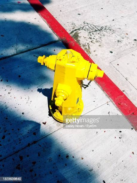 close-up of yellow umbrella - casey nolan stock pictures, royalty-free photos & images