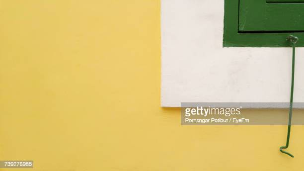 close-up of yellow wall - wall building feature stock pictures, royalty-free photos & images