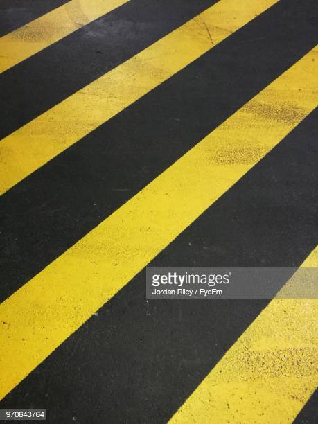 Close-Up Of Yellow Zebra Crossing On Road