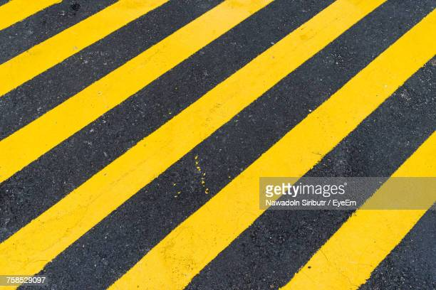 close-up of yellow zebra crossing - double yellow line stock photos and pictures