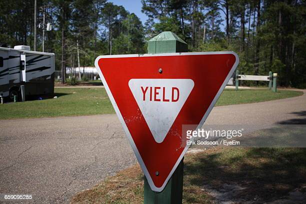 Close-Up Of Yield Sign At Roadside