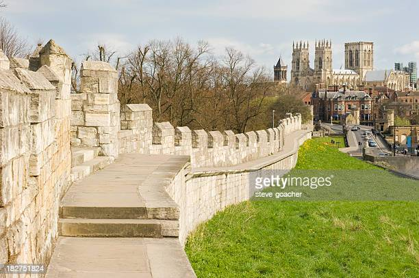Closeup of York City wall with castle in the background