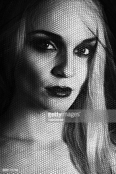 B&W closeup of young blonde woman in black veil