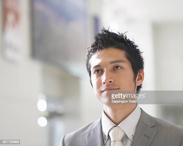 close-up of young businessman - 目をそらす ストックフォトと画像