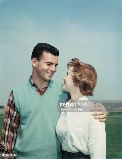 close-up of young couple looking at each other - 1950 1959 photos stock photos and pictures