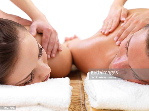Close-up of young couple receiving shoulder massage at day spa