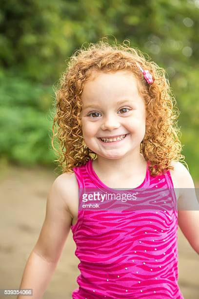 Close-Up of Young Girl With Curly Red Hair
