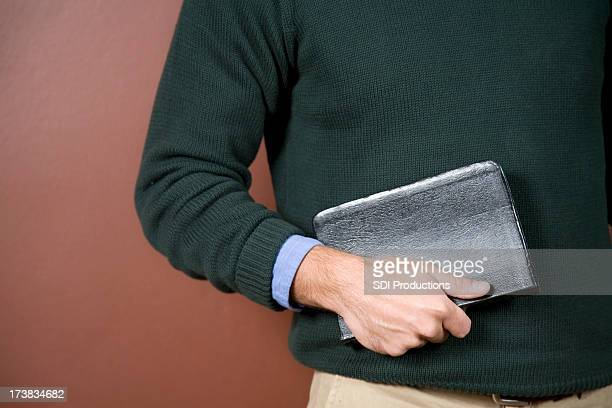 Closeup of Young Man Holding Bible With Copy Space