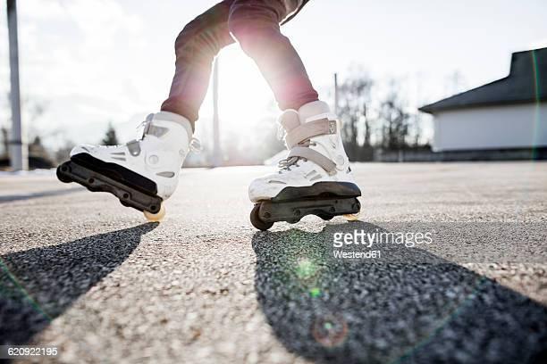 Close-up of young man inline skating