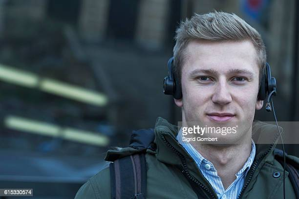 close-up of young man listening to music with headset, freiburg im breisgau, baden-württemberg, germany - baden württemberg foto e immagini stock