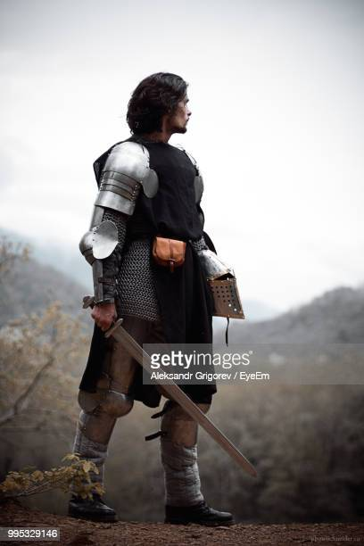 close-up of young man wearing costume while standing against sky - medieval fotografías e imágenes de stock