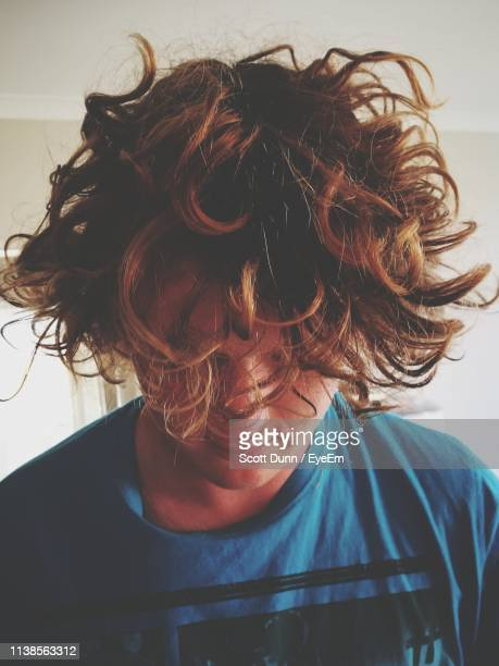 close-up of young man with tousled hair at home - crazy hair stock pictures, royalty-free photos & images