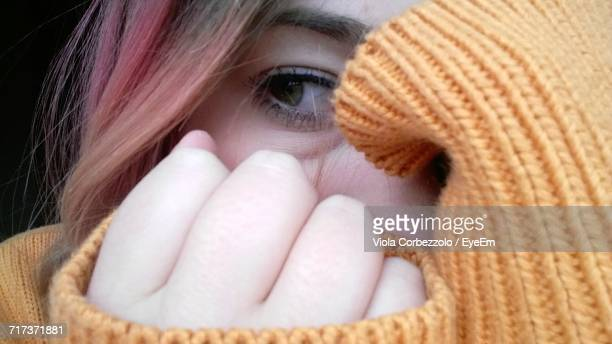 close-up of young woman covering face with hands - terrified stock pictures, royalty-free photos & images