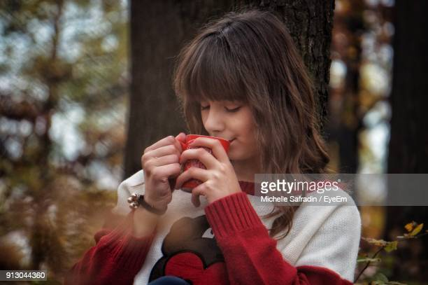 Close-Up Of Young Woman Drinking Coffee