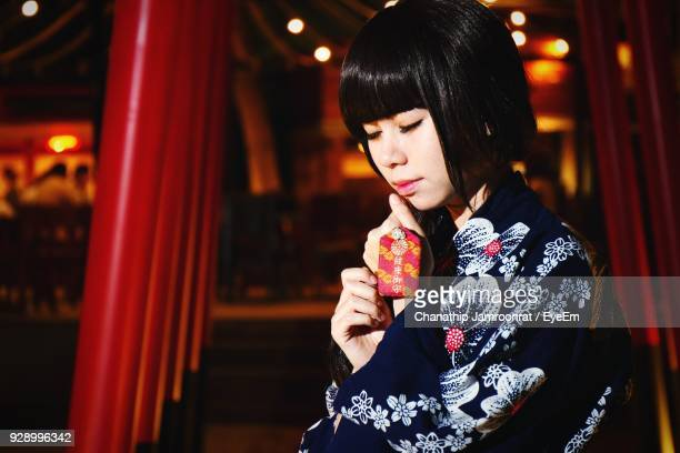 Close-Up Of Young Woman In Kimono At Night