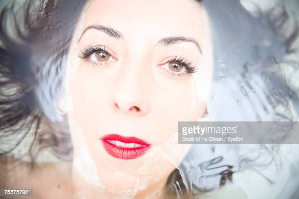 Close-Up Of Young Woman In Water
