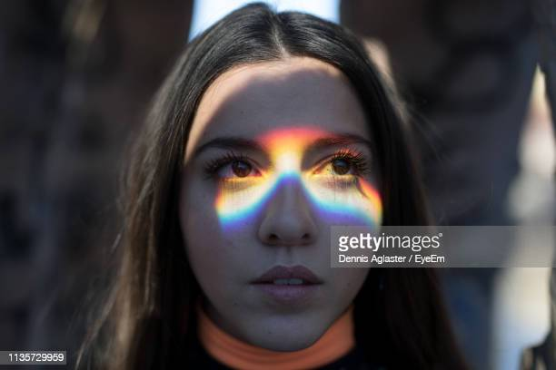 close-up of young woman looking away - spectrum stock pictures, royalty-free photos & images