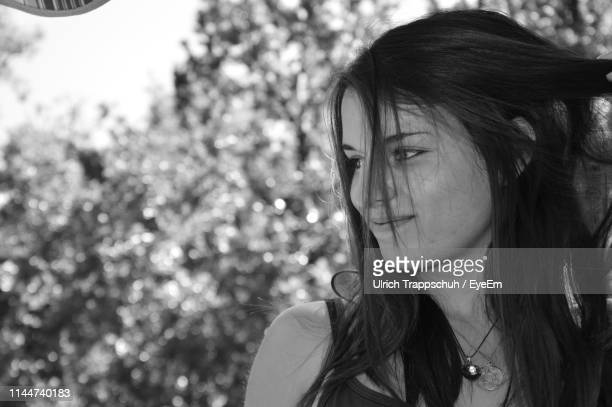 close-up of young woman looking away - alpes de haute provence stock photos and pictures