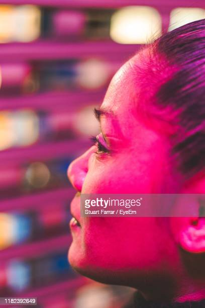 close-up of young woman looking away - brixton stock pictures, royalty-free photos & images