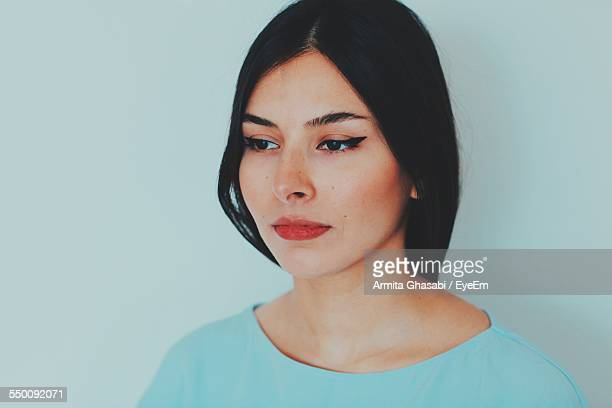 close-up of young woman looking away - iranian woman stock photos and pictures