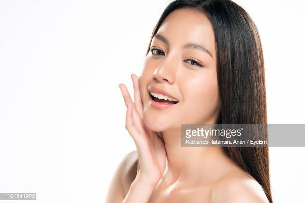 close-up of young woman over white background - 人の肌 ストックフォトと画像