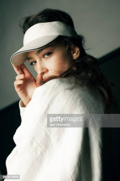 close-up of young woman posing in studio - taking a shot sport stock pictures, royalty-free photos & images