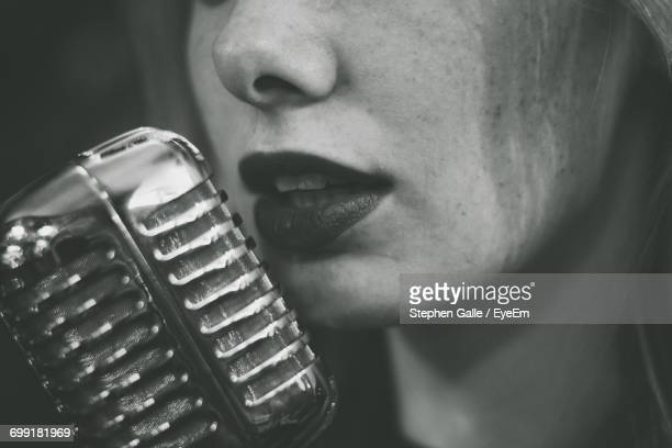 Close-Up Of Young Woman Singing