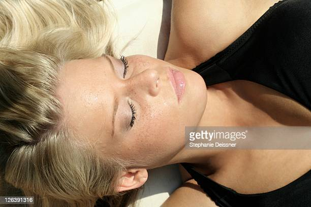 Close-up of young woman sleeping