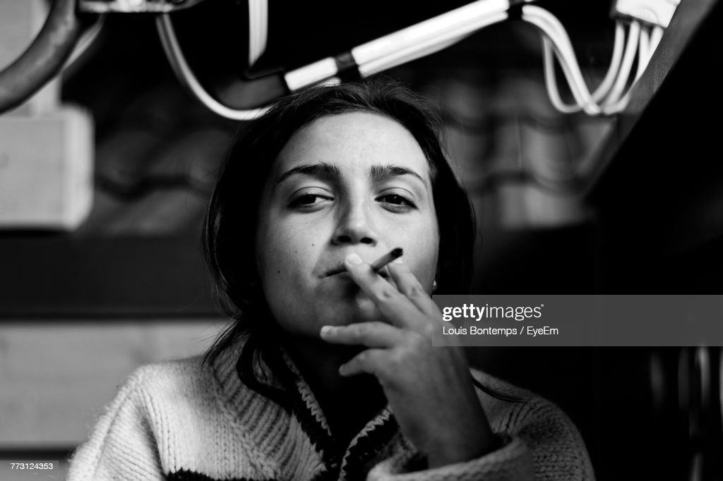 Close-Up Of Young Woman Smoking Cigarette : Stock Photo