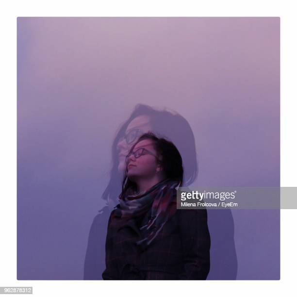 close-up of young woman standing clear sky - transferbild stock-fotos und bilder