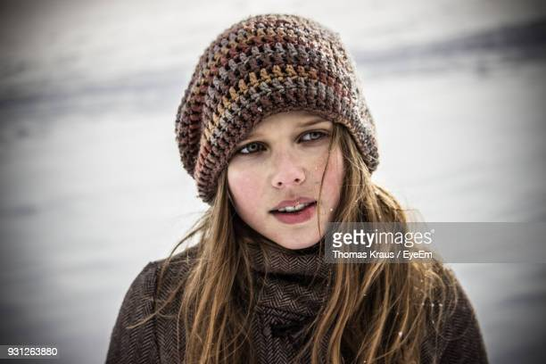 Close-Up Of Young Woman Standing Outdoors During Winter