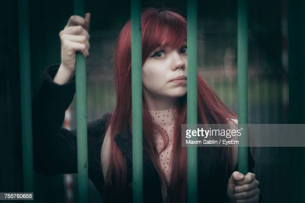 close-up of young woman standing outdoors - woman prison stock-fotos und bilder