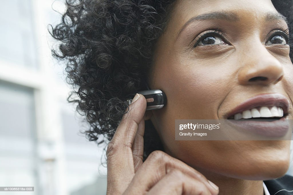 Close-up of young woman using headset : Foto stock