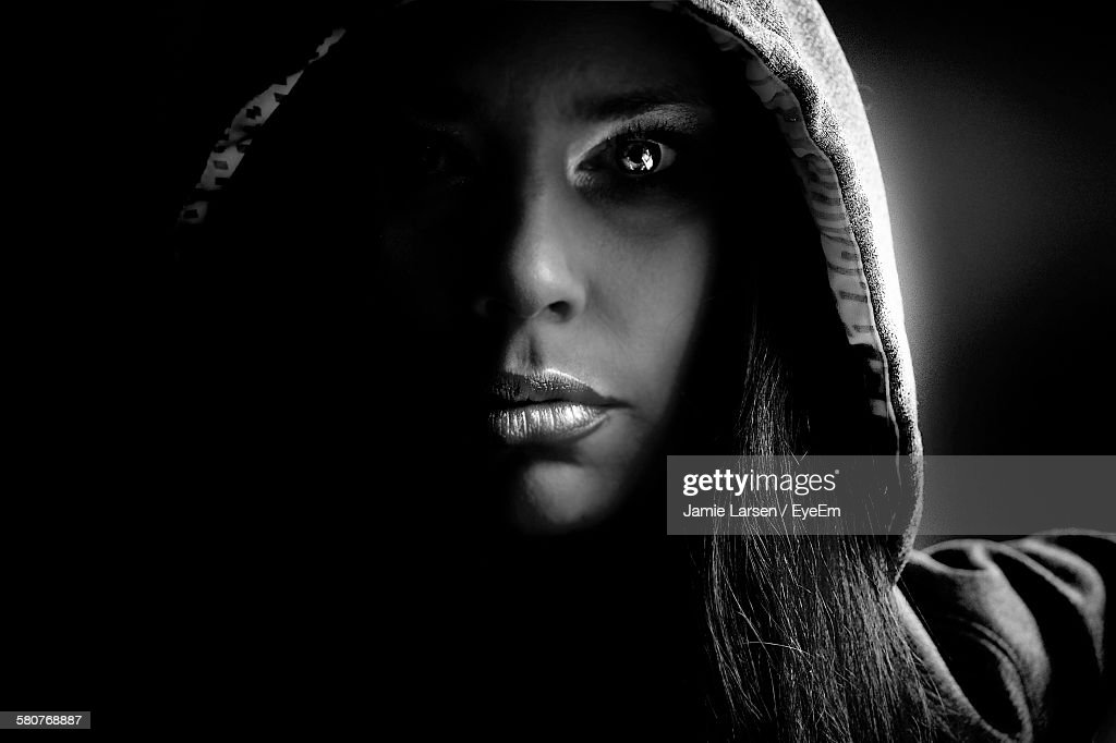 Close-Up Of Young Woman Wearing Hooded Shirt At Home : Stock Photo