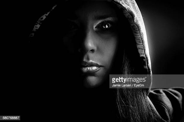 Close-Up Of Young Woman Wearing Hooded Shirt At Home